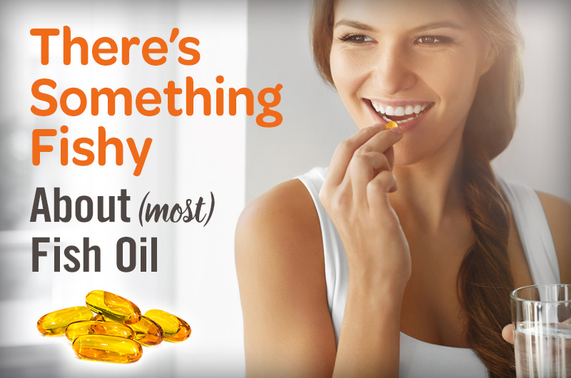 There's something fishy about most fish oil, woman smiling as she takes a capsule